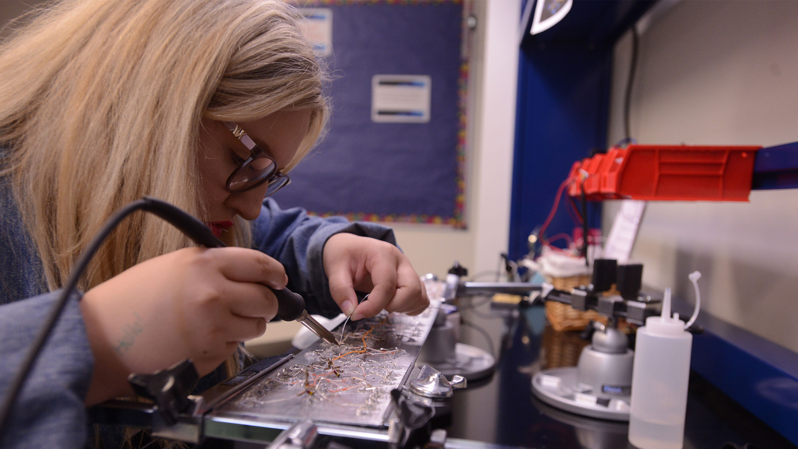 photo: Student working on circuit board