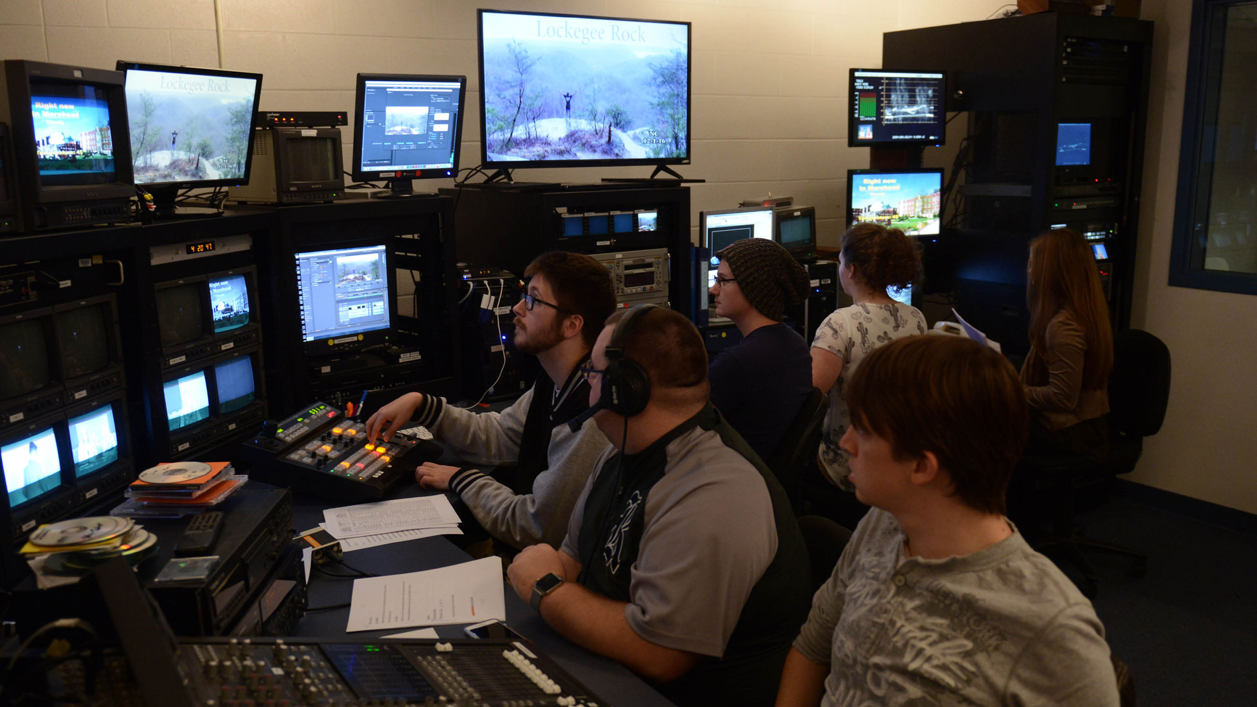 Students in a TV control room.