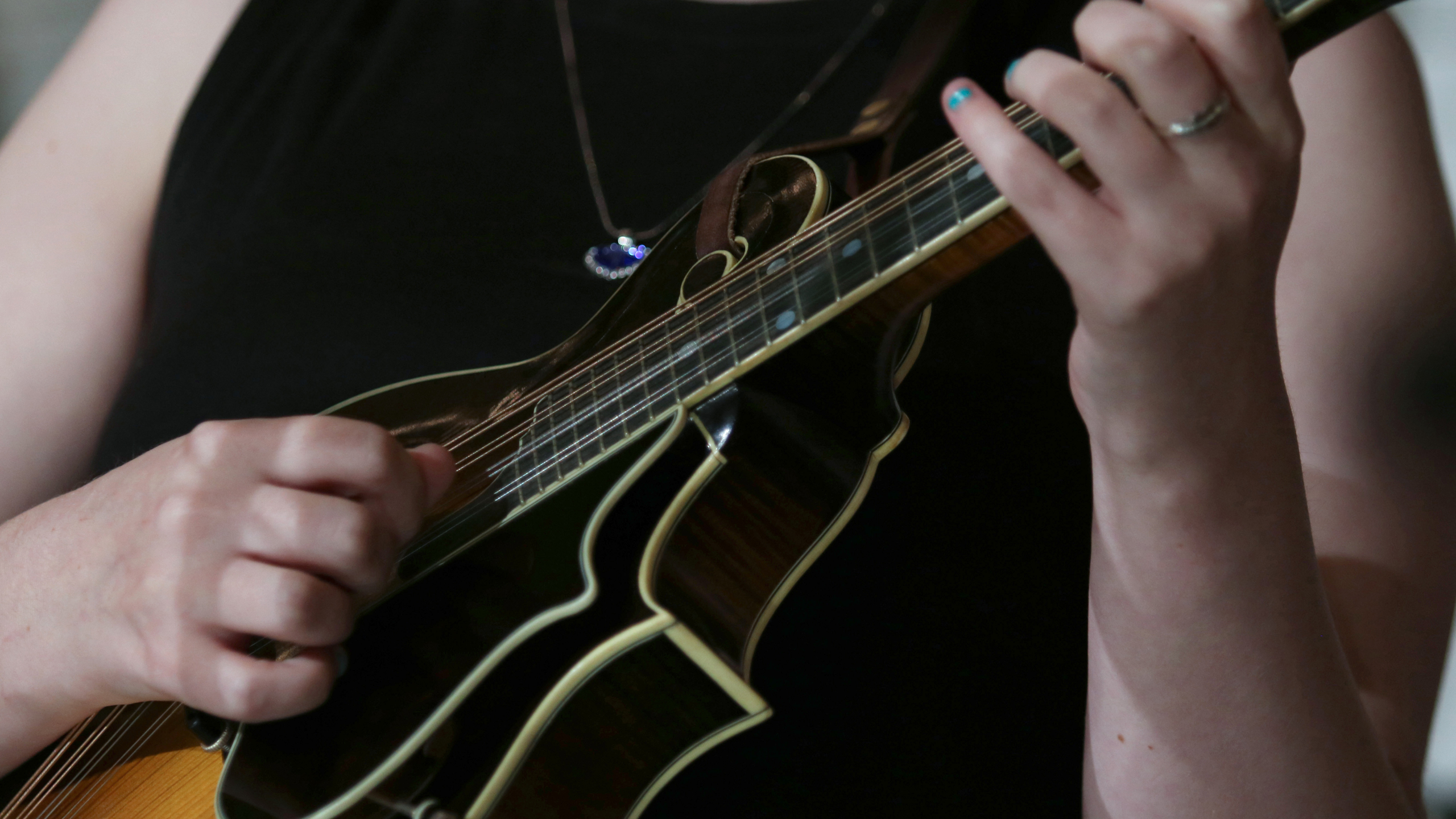 student playing a mandolin