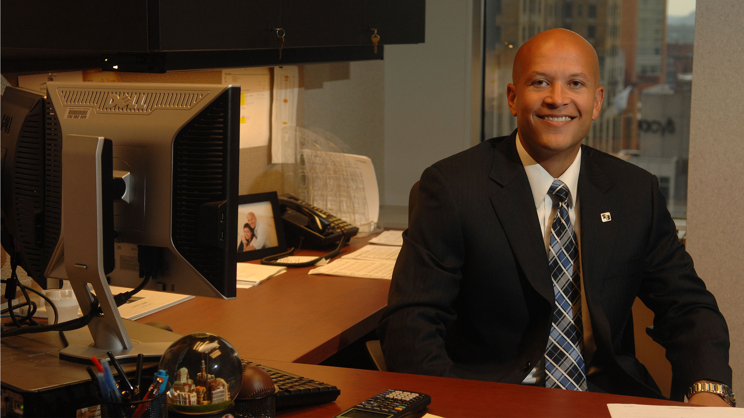 A businessman sitting at his desk.