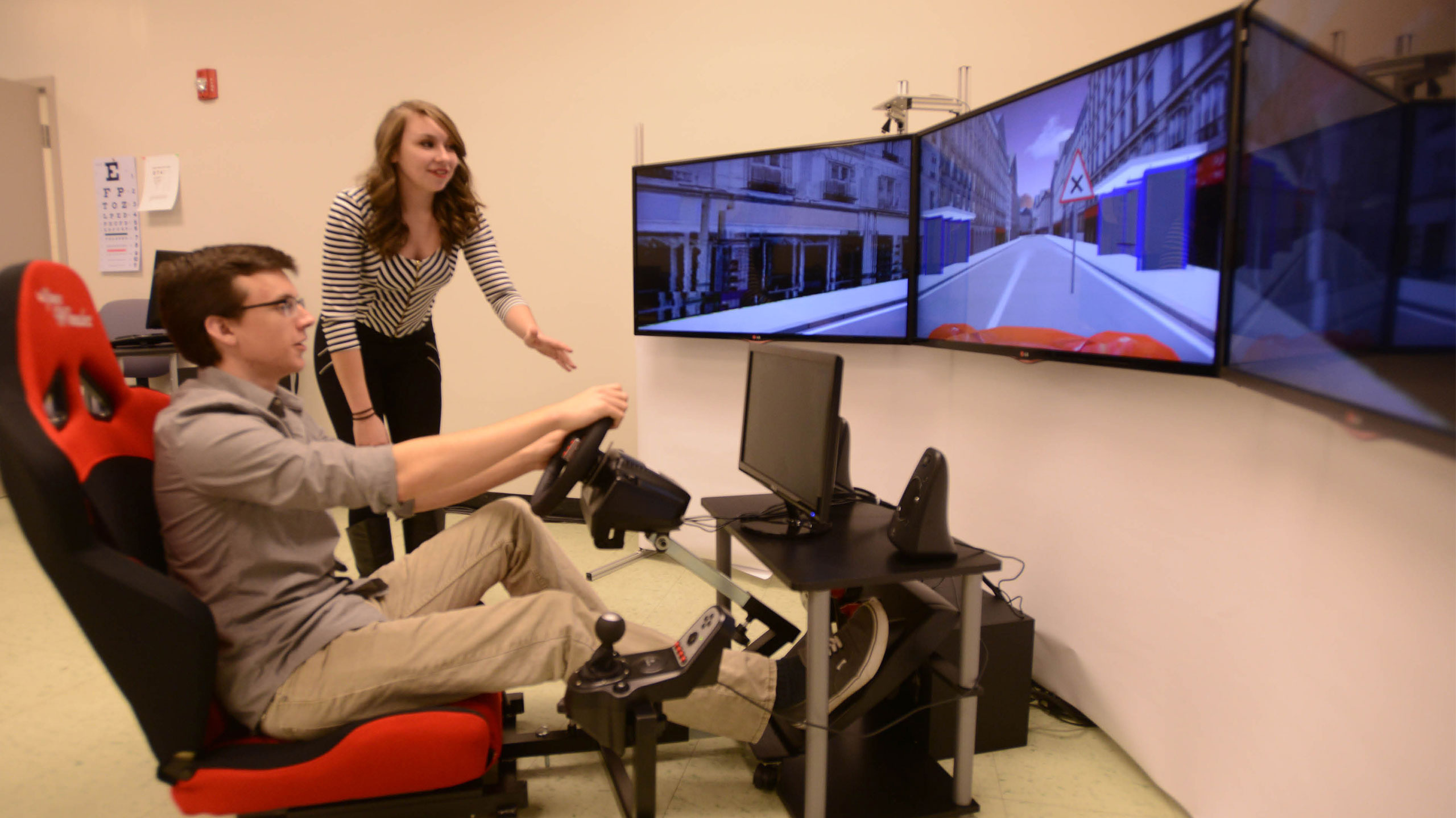Students using a driving simulator.