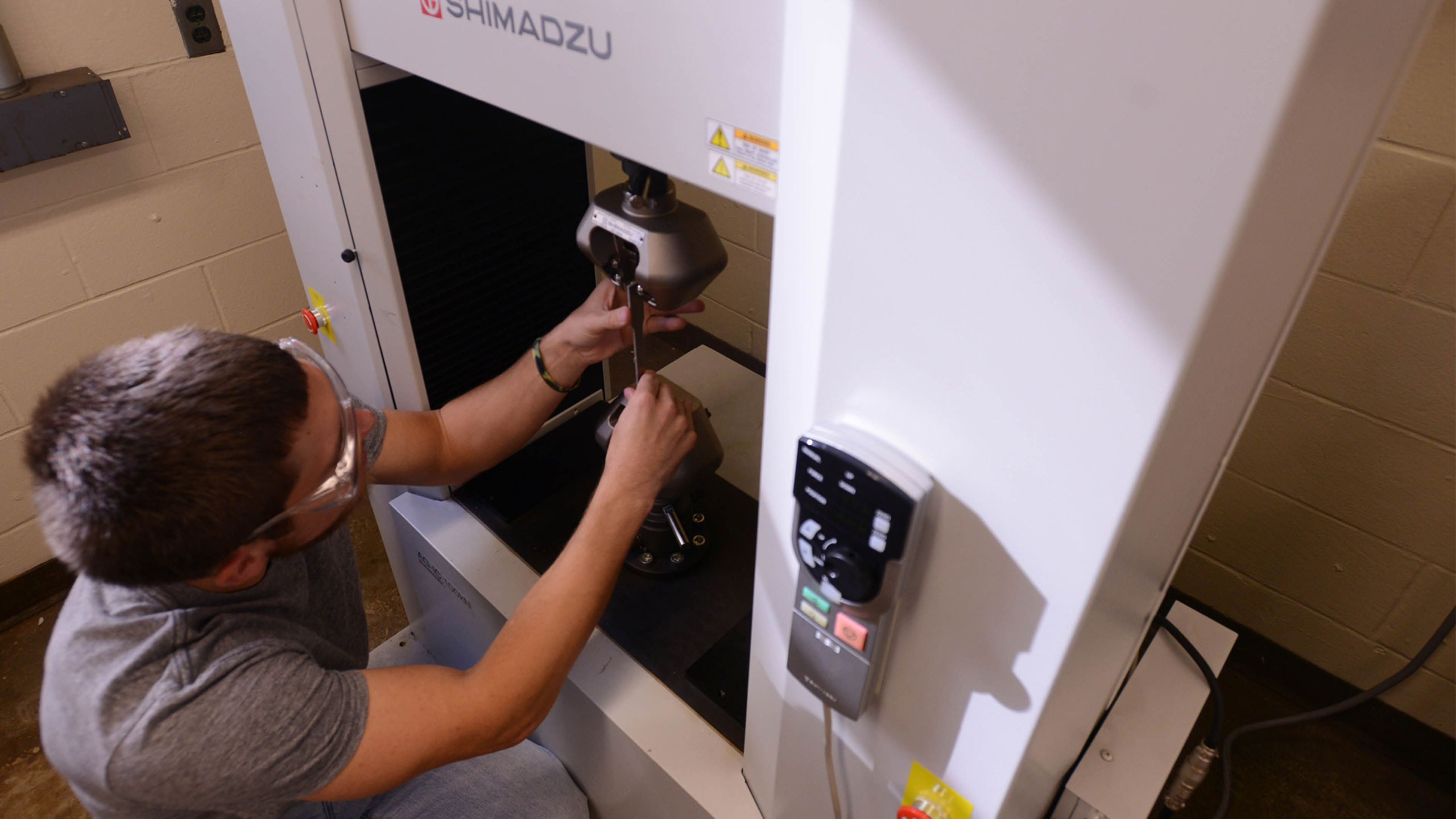 A student working with a piece of equipment.