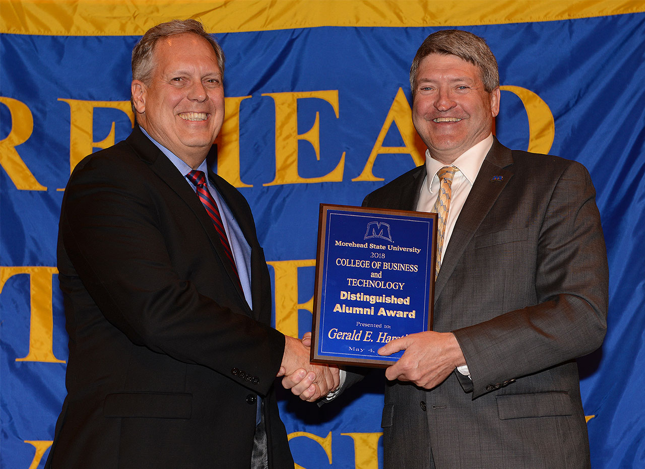 Pictured from left are Gerry Harstine and Dr. Bob Albert, dean of the College of Business and Technology.