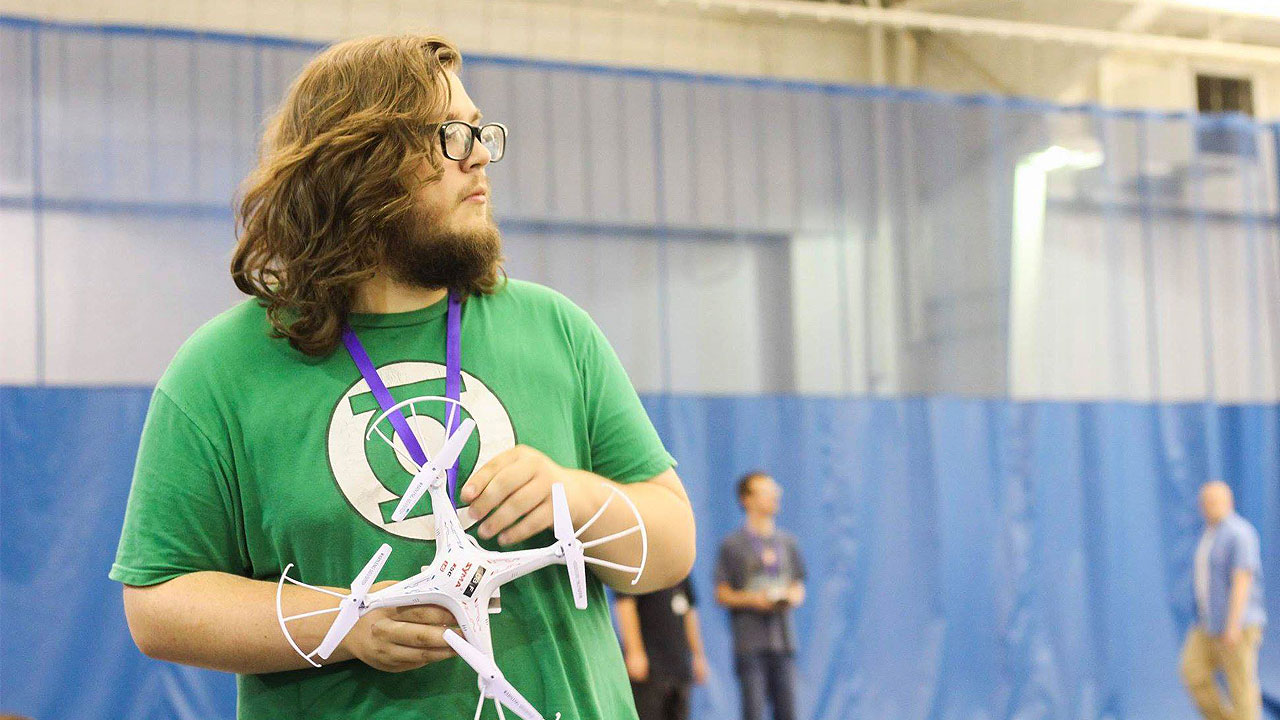 Student holding drone