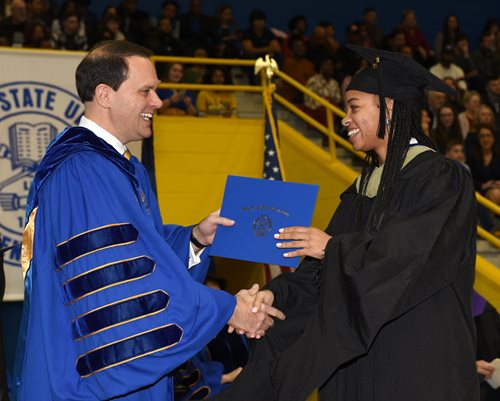 President Morgan congratulates a graduate student at Commencement.