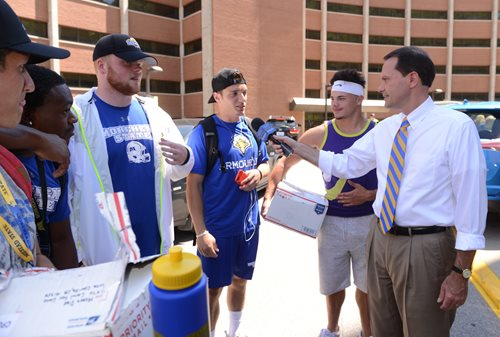 President Morgan talks with student-athletes as they help out on Move-in Day.