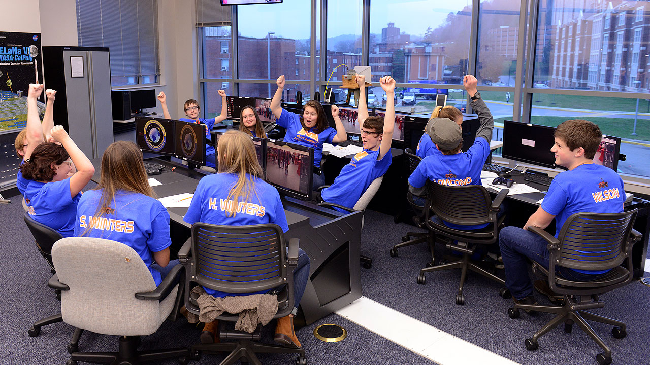 Students celebrate after a successful Mars rover simulation.